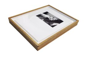 Photo of limited edition photographic print, float-mounted in a minimal natural timber box frame with finger-joins, and white mat board spacers (on the inside of the frame)